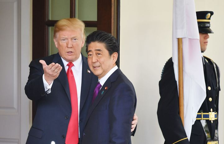 President Donald Trump greets Japanese Prime Minister Shinzo Abe upon his arrival at the White House on June 7.