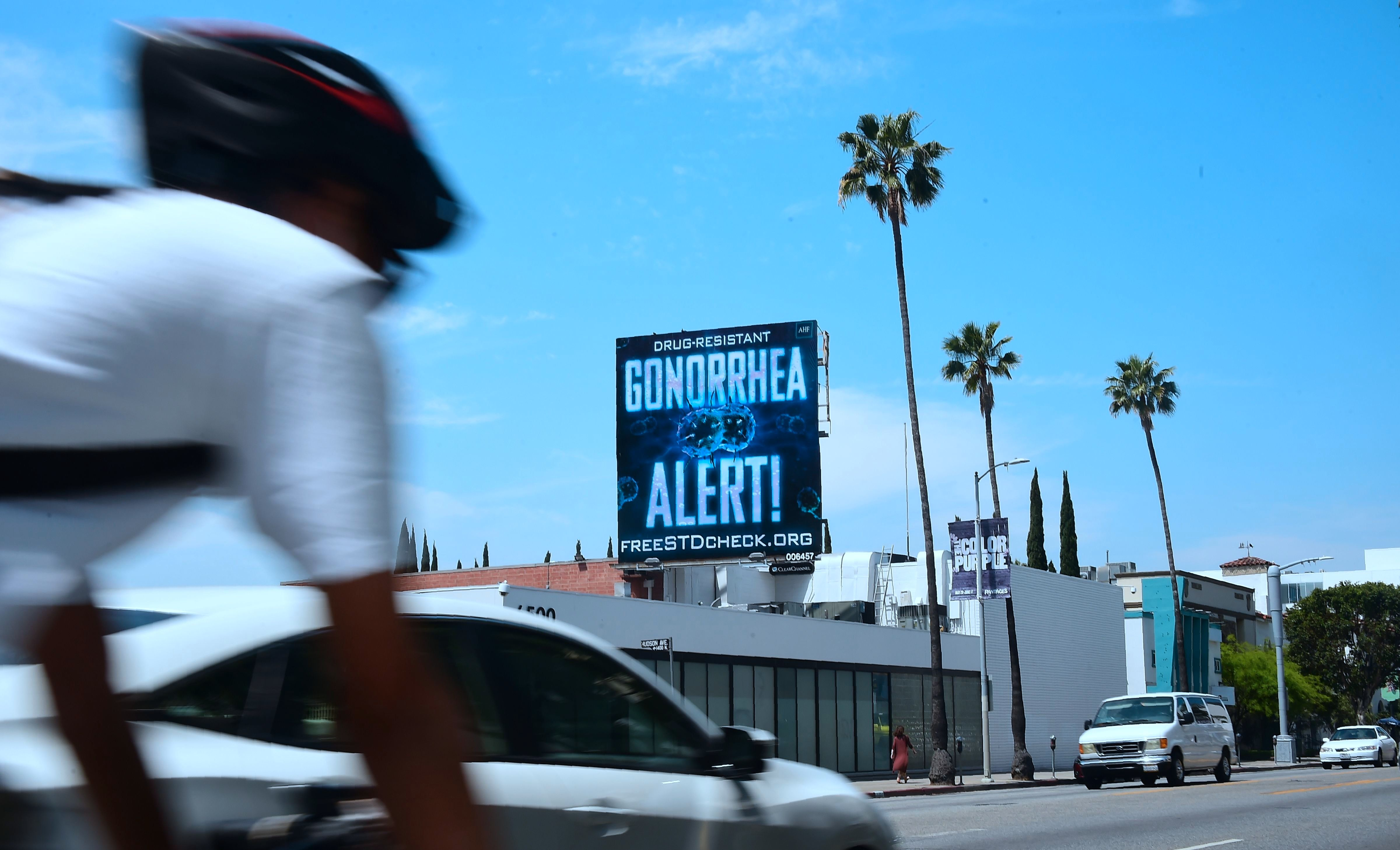 A billoard from the AIDS Healthcare Foundation (AHF) is seen on Sunset Boulevard in Hollywood, California on May 29, 2018 warning of a drug resistant Gonorrhea. - A billboard on Sunset Boulevard in Hollywood screams out a stark warning: 'drug-resistant gonorrhea alert!' Sexually transmitted diseases have made an alarming resurgence across the US, where 2016 saw a record two million cases of chlamydia, gonorrhea and syphilis, including 628 cases of congenital syphilis. But California, the most populous US state, stands out for its willingness to tackle the crisis head-on, with cases of the three ailments up 45 percent in 2017 from five years ago. (Photo by Frederic J. BROWN / AFP) / TO GO WITH AFP STORY by Javier TOVAR, 'California on front line as STDs run rampant in US'        (Photo credit should read FREDERIC J. BROWN/AFP/Getty Images)
