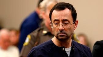 Former Michigan State University and USA Gymnastics doctor Larry Nassar addresses the court during the sentencing phase in Ingham County Circuit Court on January 24, 2018 in Lansing, Michigan.  Disgraced former USA Gymnastics doctor Larry Nassar was sentenced to 40 to 175 years in prison on Wednesday for sexually abusing scores of young girls under the guise of medical treatment. 'I've just signed your death warrant,' Judge Rosemarie Aquilina said as she handed down the sentence after a week of gut-wrenching testimony by over 150 of Nassar's victims.  / AFP PHOTO / JEFF KOWALSKY        (Photo credit should read JEFF KOWALSKY/AFP/Getty Images)