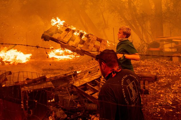 Alex Schenck, 15, fights to save his home as the Ranch fire rages near Clearlake Oaks, California, on,...