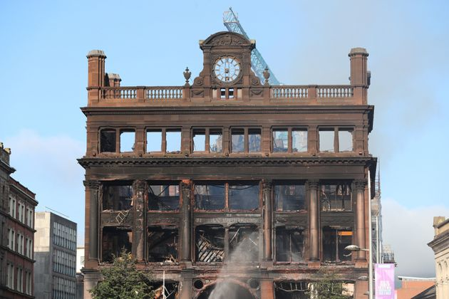 Firefighters were still hosing down the building on Wednesday
