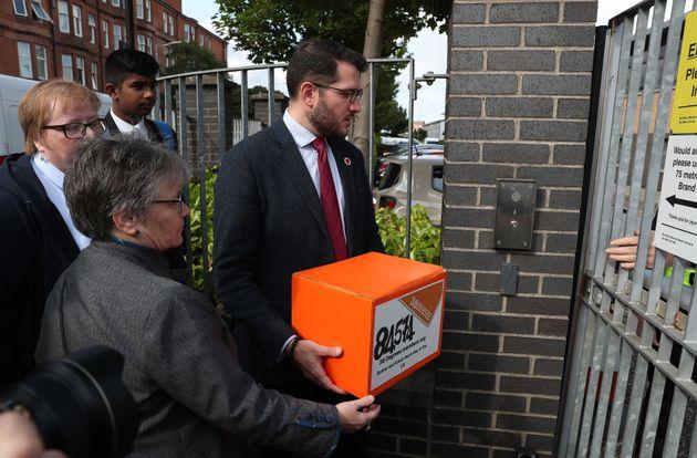 Paul Sweeney MP hands over the