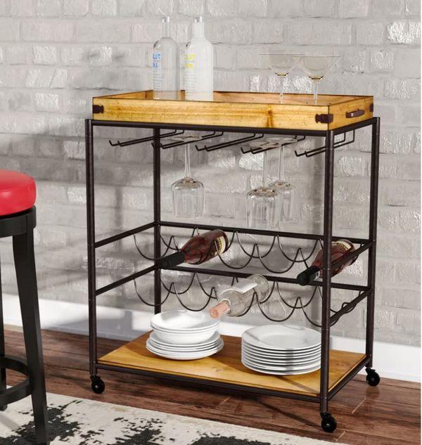 "Normally $259, on sale for $108.<br>Get it <a href=""https://www.wayfair.com/furniture/pdp/trent-austin-design-kahnah-bar-cart"