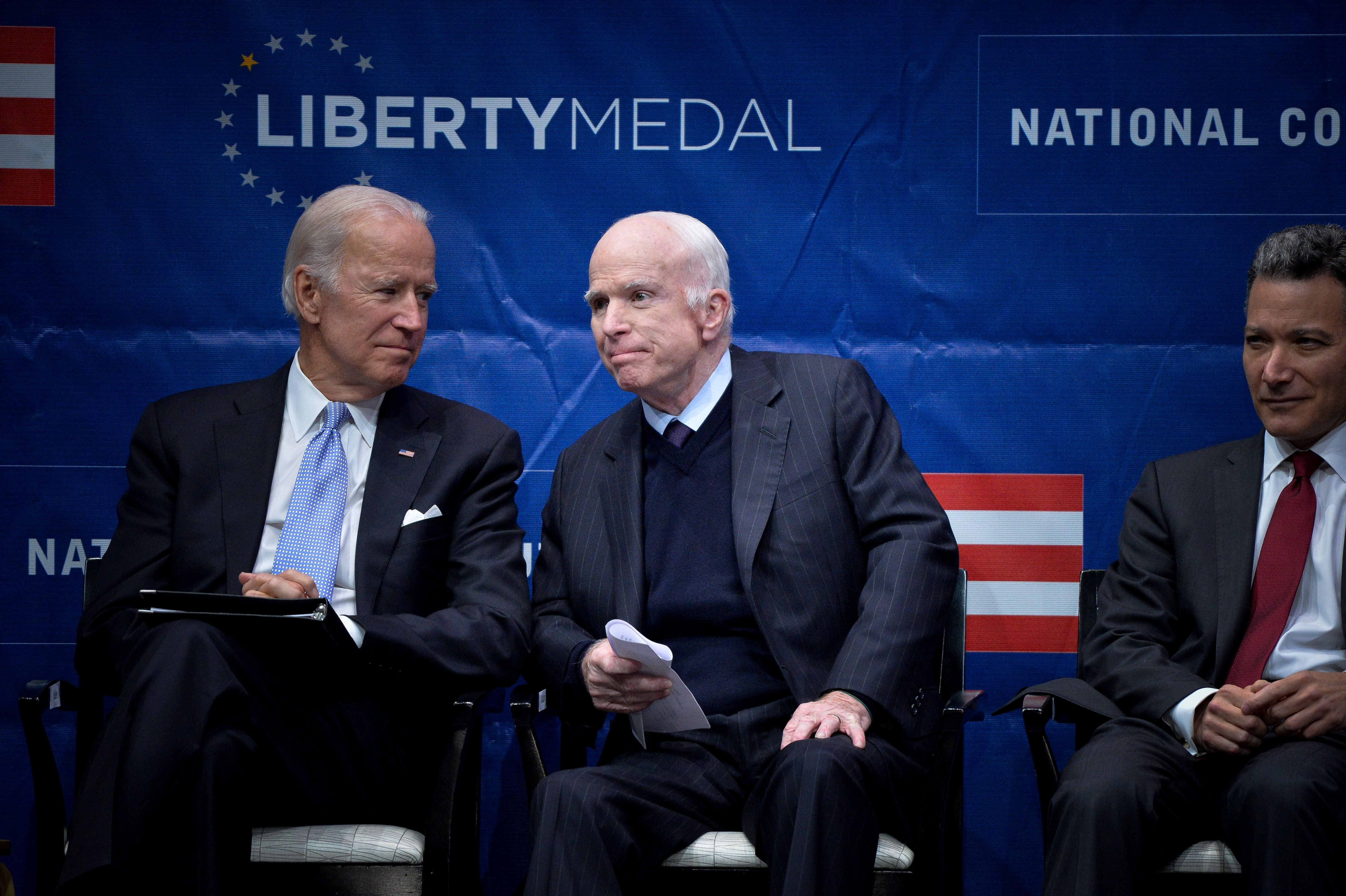 U.S. Senator John McCain (R-AZ) waits to speak before being awarded the 2017 Liberty Medal by former U.S. Vice President Joe Biden at the Independence Hall in Philadelphia, Pennsylvania, U.S., October 16, 2017. At right is President of the National Constitution Center Jeffrey Rosen. REUTERS/Charles Mostoller