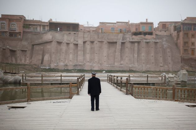 An ethnic Uighur looks at the old town in Kashgar, Xinjiang, in 2017. Per a 2012 Human Rights Watch report,...