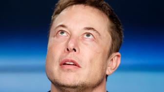 SpaceX founder Elon Musk pauses at a press conference following the first launch of a SpaceX Falcon Heavy rocket at the Kennedy Space Center in Cape Canaveral, Florida, U.S., February 6, 2018. REUTERS/Joe Skipper