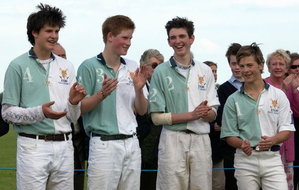 Prince Harry with his teammates from the Eton Polo Society smiling and applauding the opposing team, the Cheltenham College P