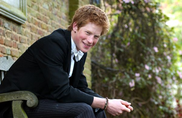 Prince Harry poses on a bench at Eton on May 12, 2003.