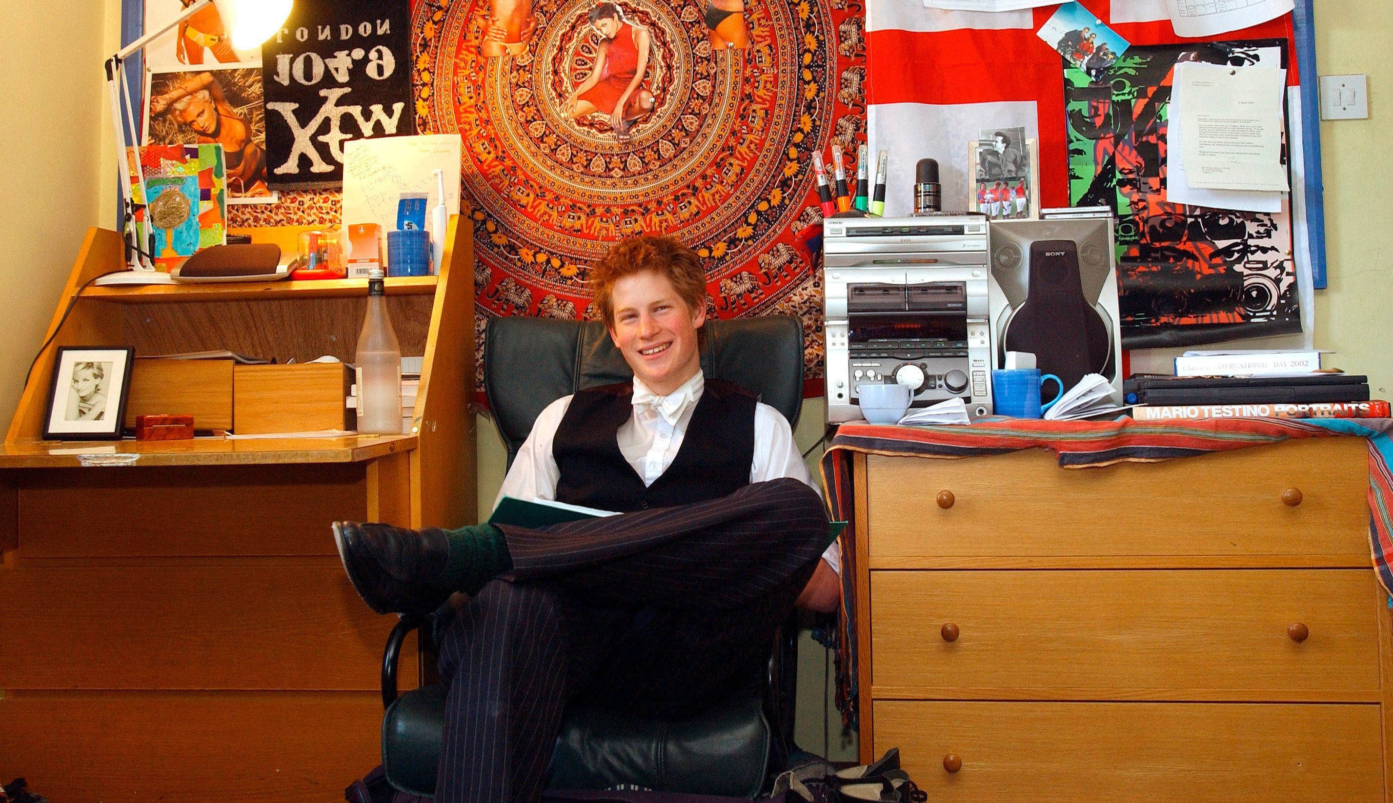 Prince Harry sits in his bedroom at Eton College. (Photo by � Pool Photograph/Corbis/Corbis via Getty Images)