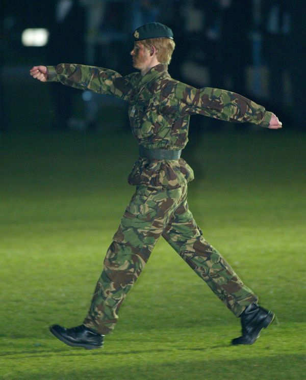 Prince Harry wears camouflage as he commands the cadets of Eton's Combined Cadet Forces during their annual tattoo.