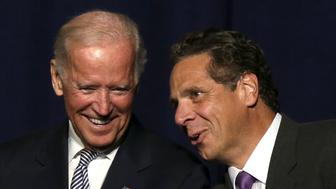 U.S. Vice President Joe Biden appears with New York Governor Andrew Cuomo on the stage at an event to discuss the economy at the Javitz Convention Center in New York, September 10, 2015. REUTERS/Brendan McDermid