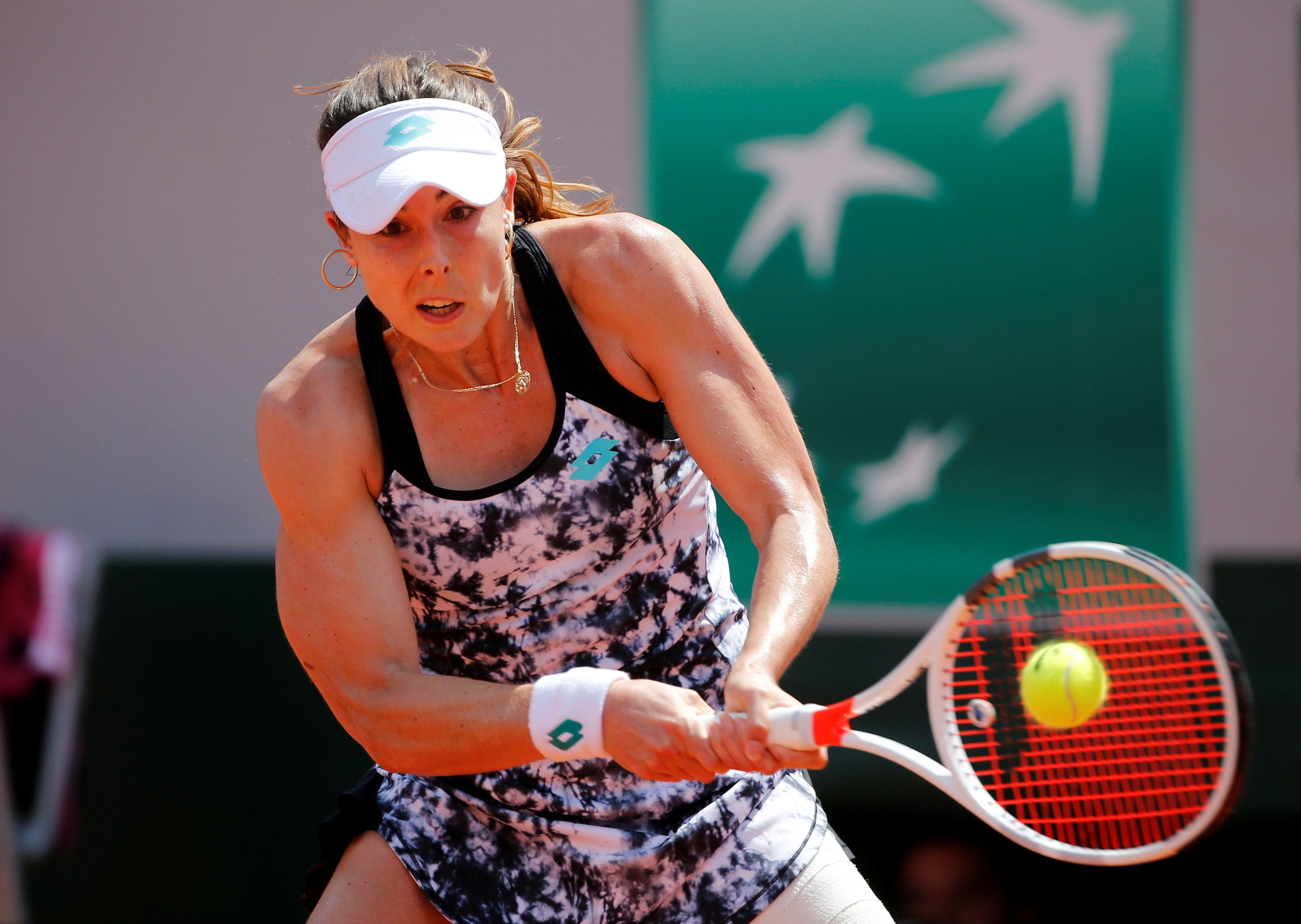 Alize Cornet hit with code violation for changing shirt on court