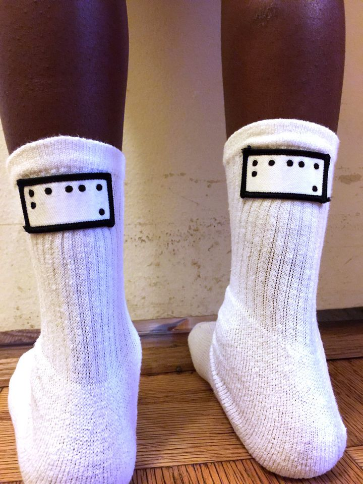 Braille Code Inc. sells products for people with vision impairments, including socks with Braille patches that designate the back from the front.