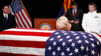 PHOENIX, AZ - AUGUST 29: Cindy McCain, wife of Sen. John McCain touches the casket during a memorial service at the Arizona Capitol on August 29, 2018, in Phoenix, Arizona. John McCain will lie in state at the Arizona State Capitol before being transported to Washington D.C. where he will be buried at the U.S. Naval Academy Cemetery in Annapolis. Sen. McCain, a decorated war hero, died August 25 at the age of 81 after a long battle with Glioblastoma, a form of brain cancer. (Photo by Jae C. Hong - Pool/Getty Images)