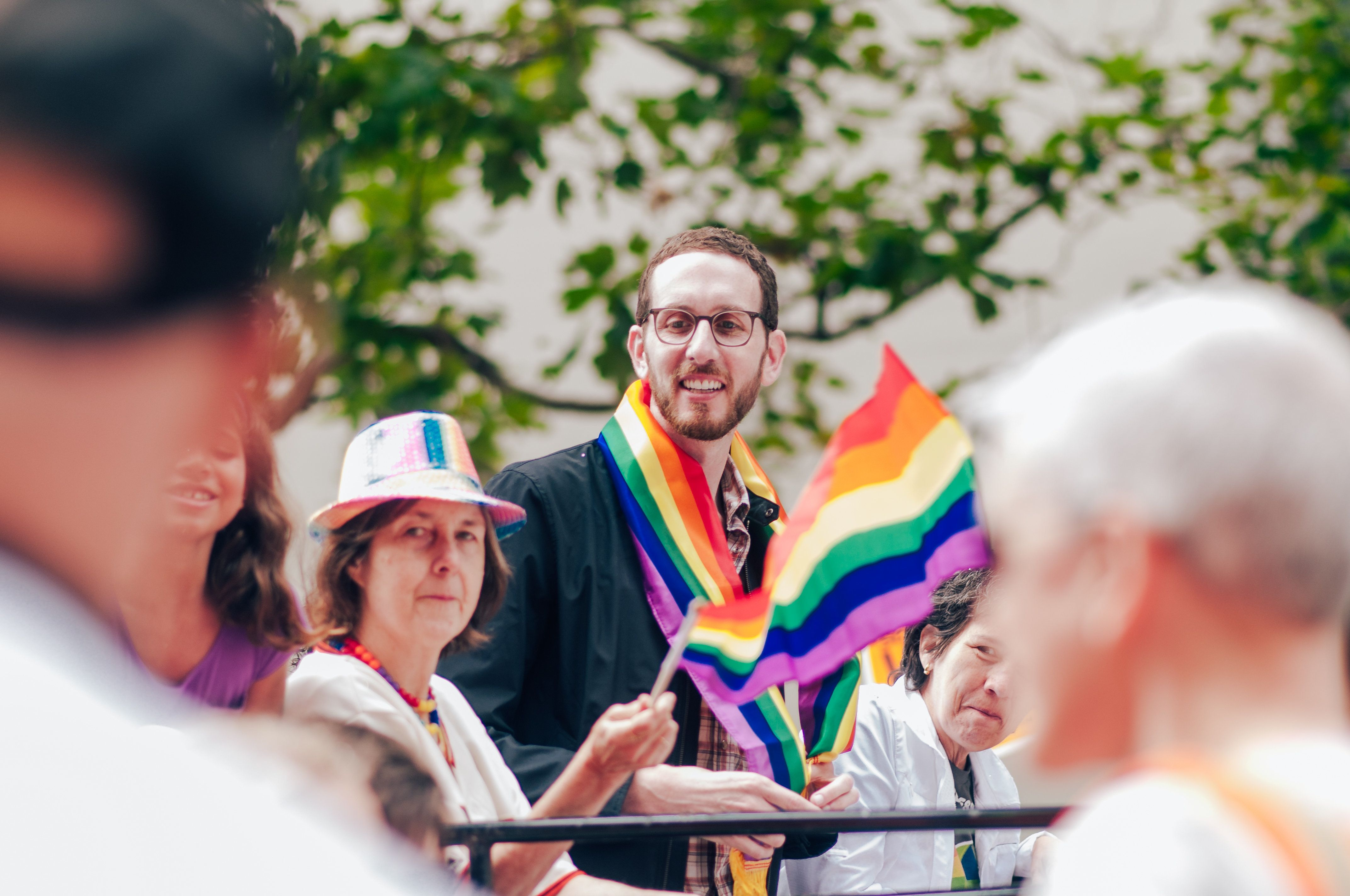 San Francisco, CA, USA - June 25, 2017: The 2017 Pride Parade California State Senator, Scott Wiener looks out into the crowd from a float in downtown San Francisco.