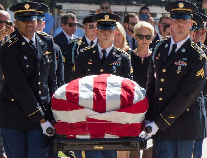Members of the Arizona National Guard carry John McCain's casket to the state Capitol Rotunda, followed by Cindy McCain