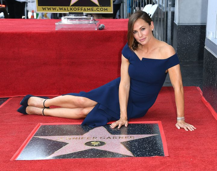 Garner poses by her new star on the Hollywood Walk of Fame on Aug. 20, 2018.