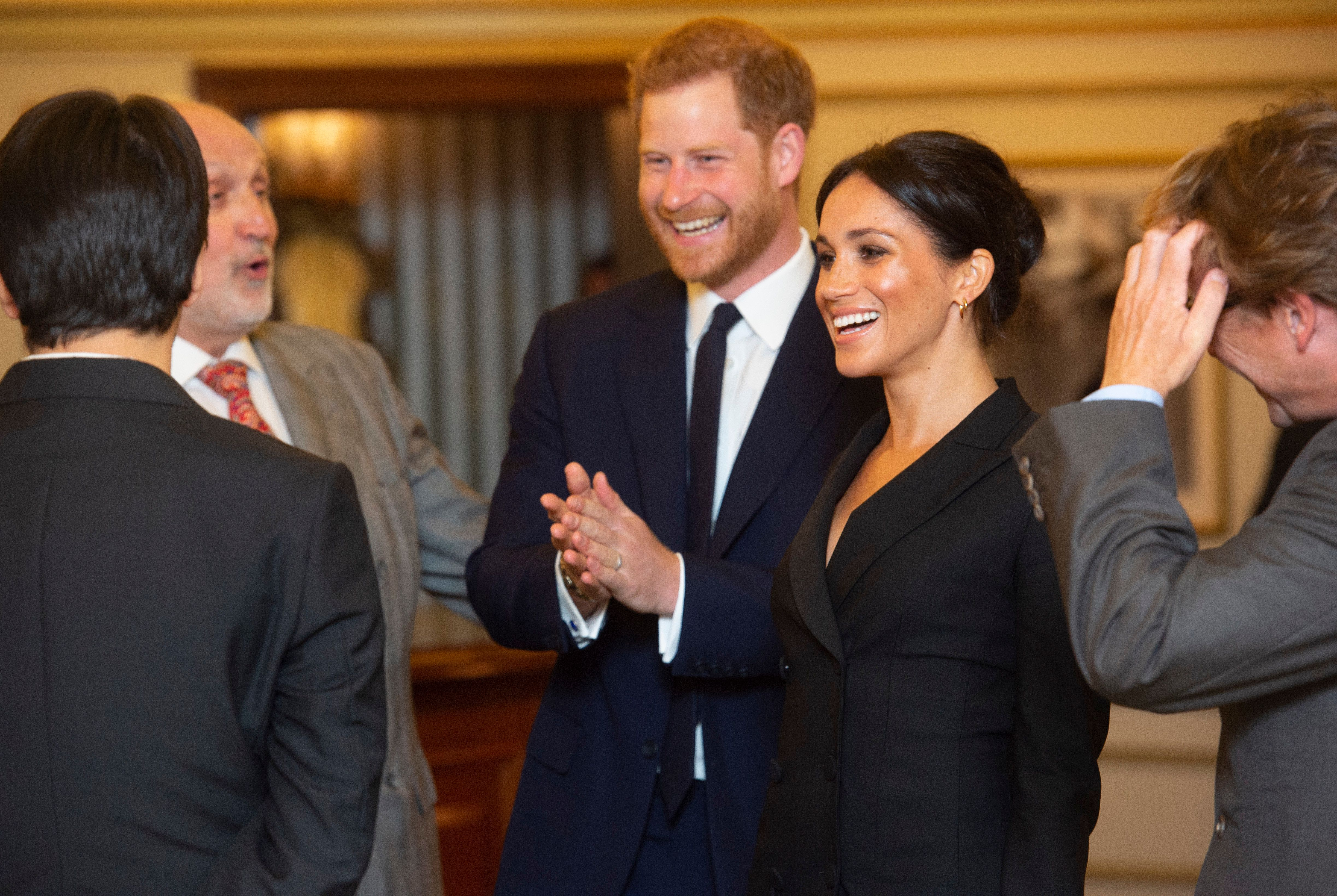 LONDON, ENGLAND - AUGUST 29: Prince William, Duke of Sussex and Meghan, Duchess of Sussex speak with writer Lin Manuel Miranda and others from Sentibale as they attend a gala performance of 'Hamilton' in support of Sentebale at Victoria Palace Theatre on August 29, 2018 in London, England. (Photo by Dan Charity - WPA Pool/Getty Images)
