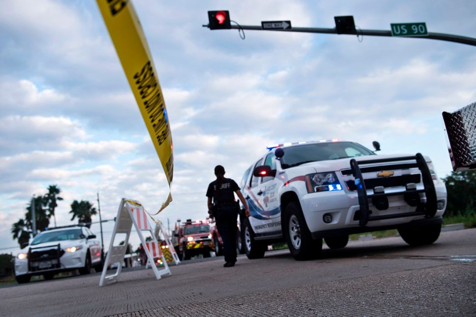Emergency vehicles wait at a roadblock in Crosby, Texas, after the Arkema plant explosion.