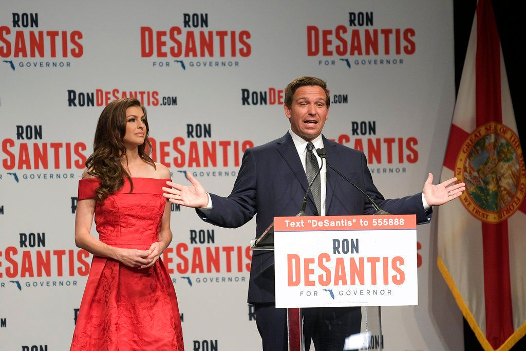 Florida Republican gubernatorial candidate Ron DeSantis right speaks to supporters with his wife Casey at an election party after winning the Republican primary Tuesday Aug 28 2018 in Orlando Fla AP Photo/Phelan M Ebenhack