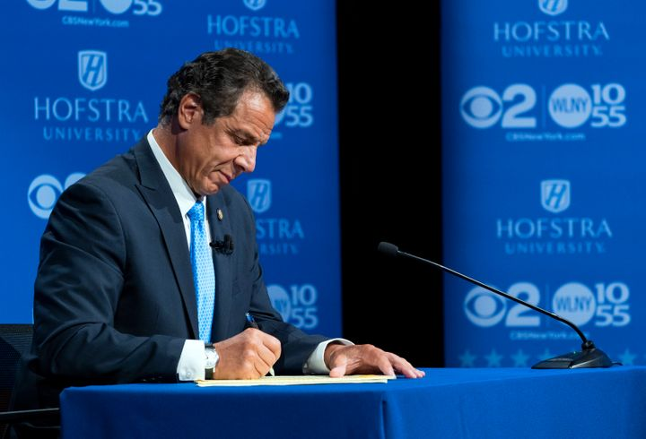 Gov. Andrew Cuomo takes notes during his debate with Democratic rival Cynthia Nixon at Hofstra University on Wednesday.
