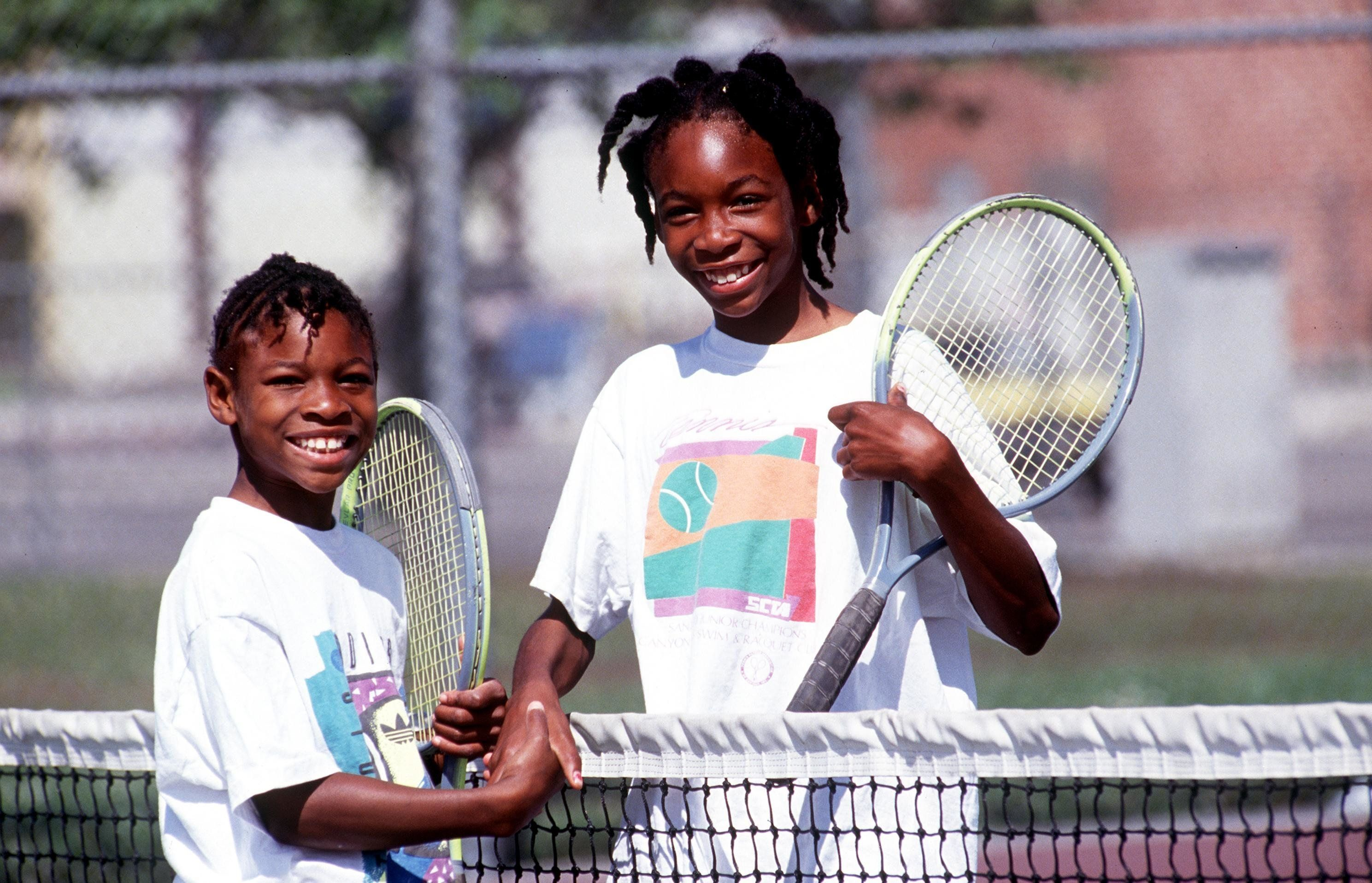 Sisters Serena, left, and Venus Williams shake hands after a game in 1991.
