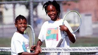 372178 11: FILE PHOTO: Sisters Serena, left, and Venus Williams shake hands after a game 1991 in Compton, CA. Serena and Venus Williams will be playing against each other for the first time July 6, 2000 in the tennis semifinals at Wimbledon. (Photo by Paul Harris/Online USA)