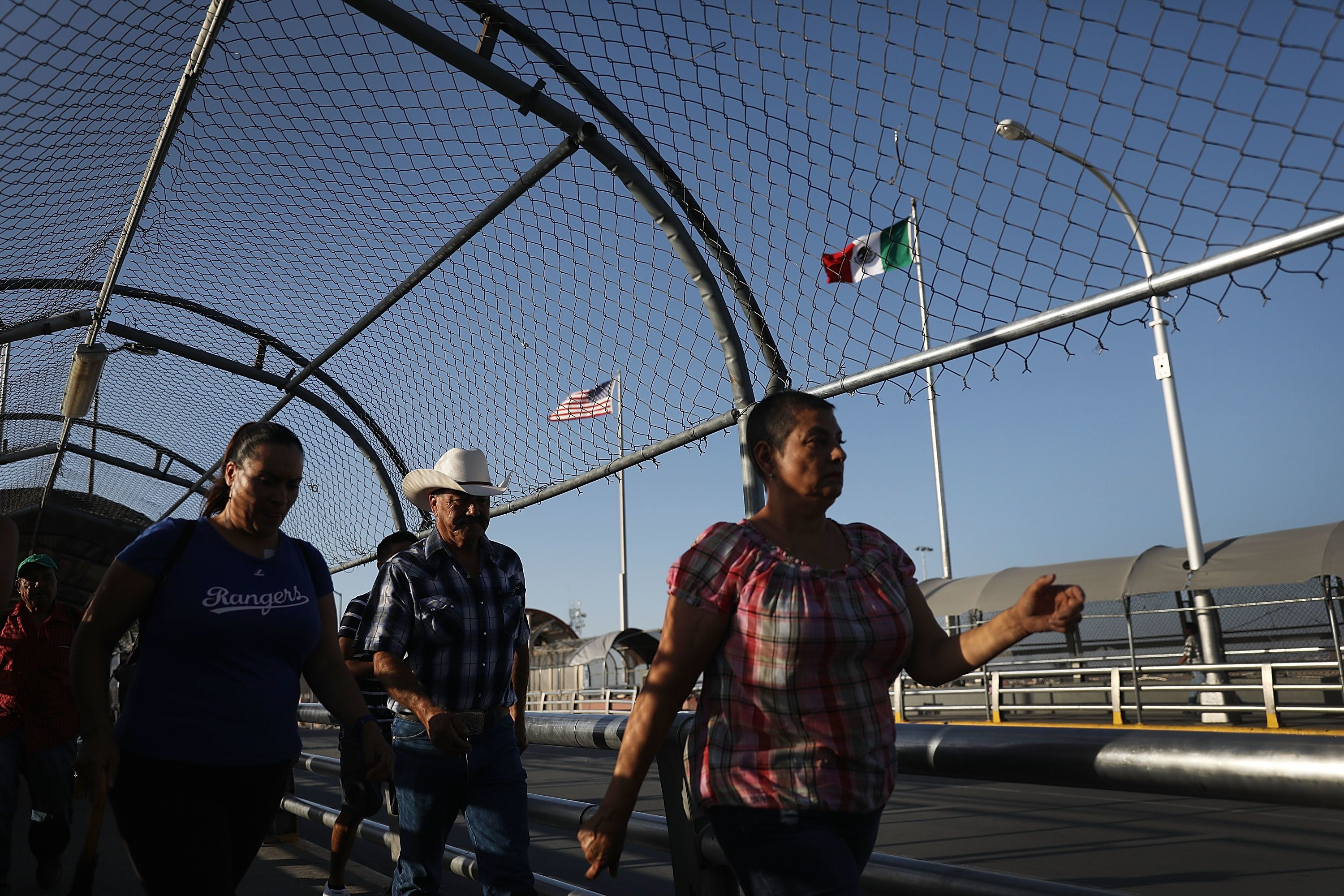 EL PASO, TX - JULY 23:  People walk across the Paso Del Norte Port of Entry bridge which connects the U.S. and Mexico on July 23, 2018 in El Paso, Texas. A court-ordered July 26th deadline is approaching for the U.S. government to reunite as many as 2,551 migrant children ages 5 to 17 that had been separated from their families after they crossed into the U.S. from Mexico along the border.  (Photo by Joe Raedle/Getty Images)