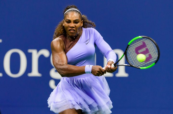 Serena Williams muscles up on a shot in her straight-set victory Wednesday.