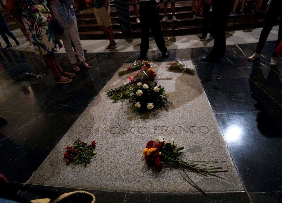Flowers lie on the tomb of Spanish dictator Francisco Franco at the Valley of the