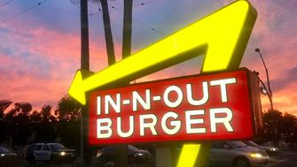 La Habra, California: An illuminated In-N-Out Burger sign at sunset in La Habra, California