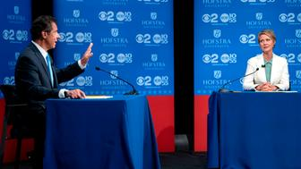 New York Governor Andrew Cuomo answers a question as  Democratic New York gubernatorial candidate Cynthia Nixon looks on during a gubernatorial debate at Hofstra University in Hempstead, New York, on August 29, 2018. (Photo by Craig Ruttle / POOL / AFP)        (Photo credit should read CRAIG RUTTLE/AFP/Getty Images)