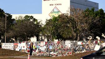 A memorial seen outside of Marjory Stoneman Douglas High School as students arrive for the first time since the mass shooting in Parkland, Florida, U.S., February 28, 2018. REUTERS/Mary Beth Koeth