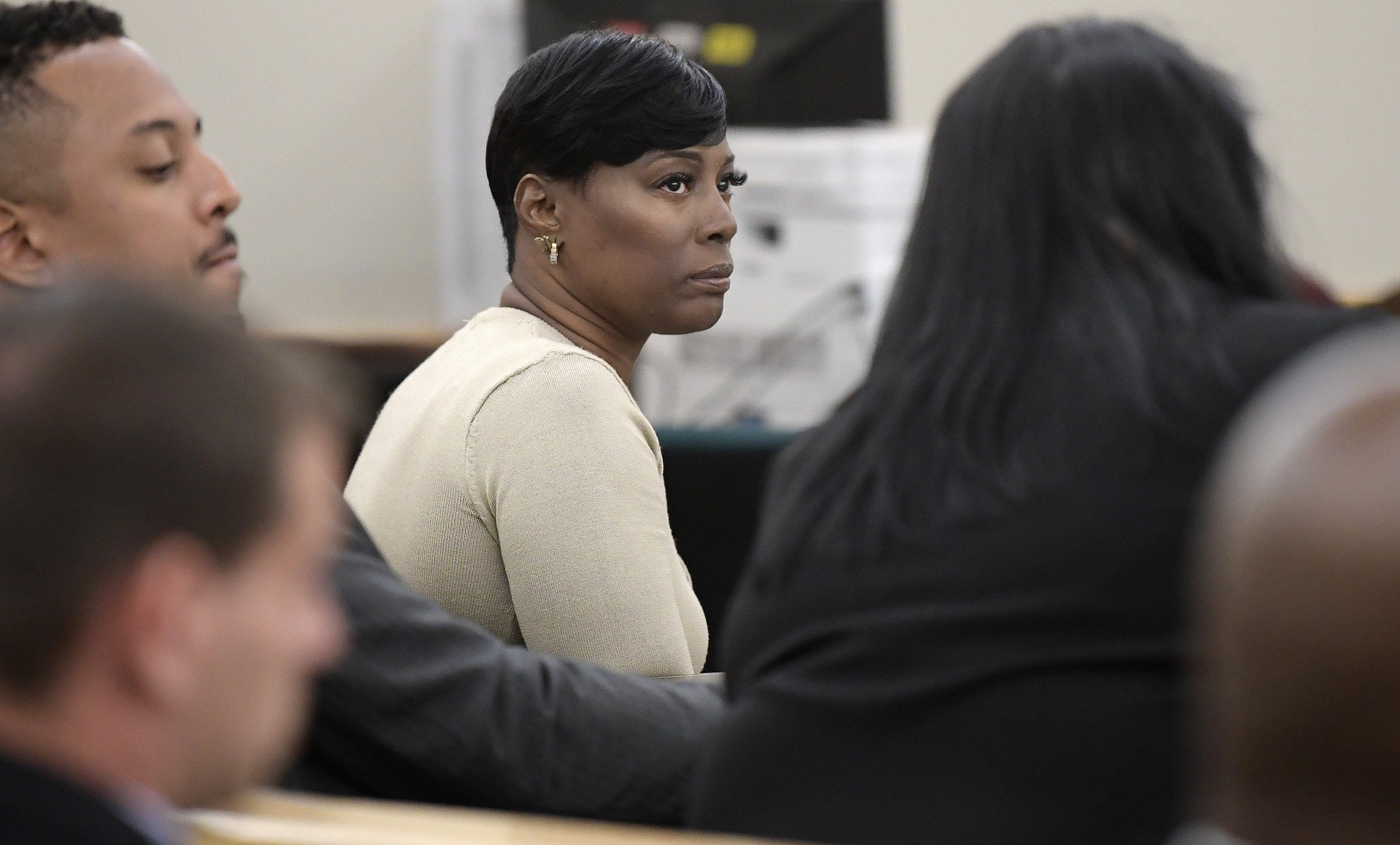 Crystal Mason, middle, convicted for illegal voting and sentenced to five years in prison, sitting at the defense table at Tim Curry Justice Center in Fort Worth, Texas, on May 25, 2018. (Max Faulkner/Fort Worth Star-Telegram/TNS via Getty Images)