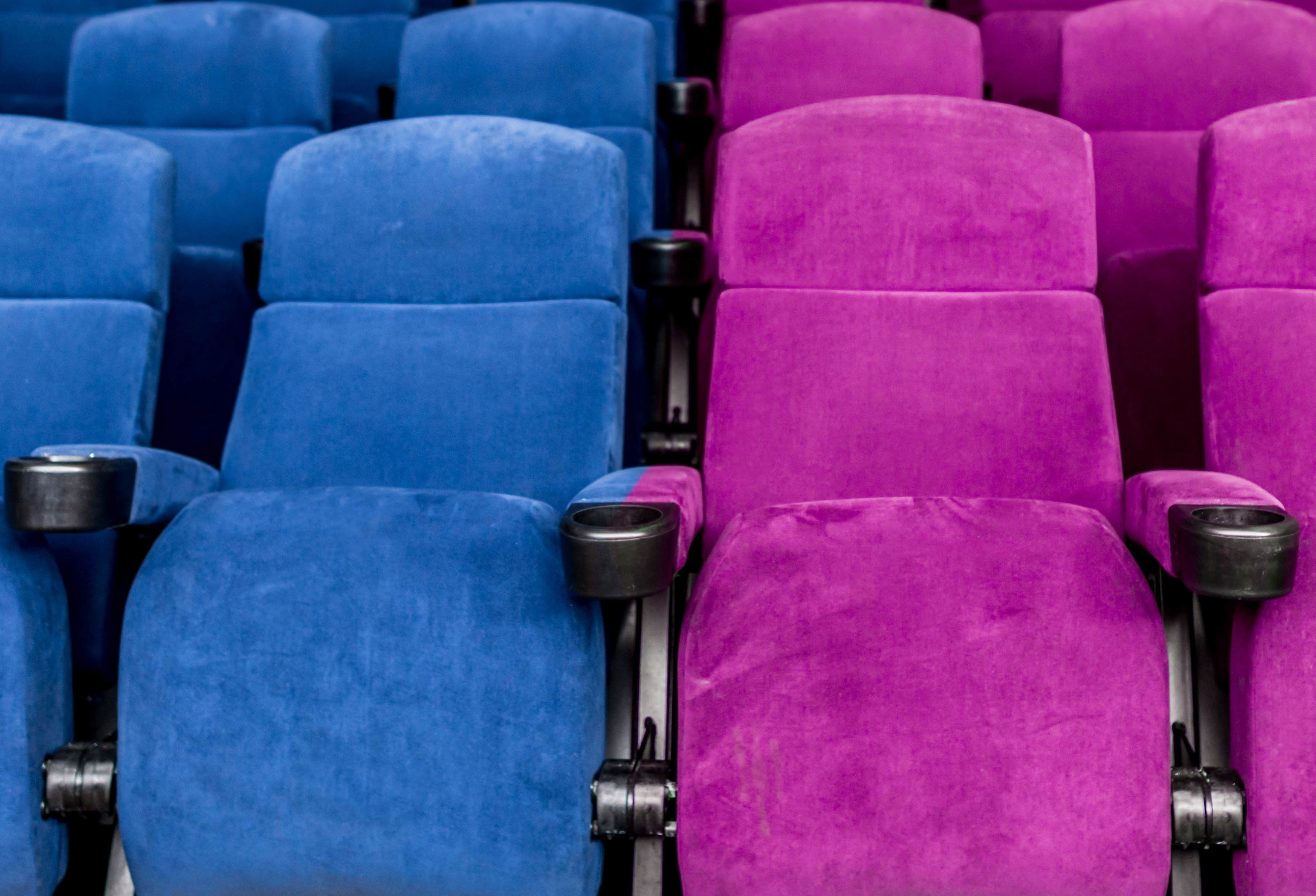 Empty movie theatre with blue chairs