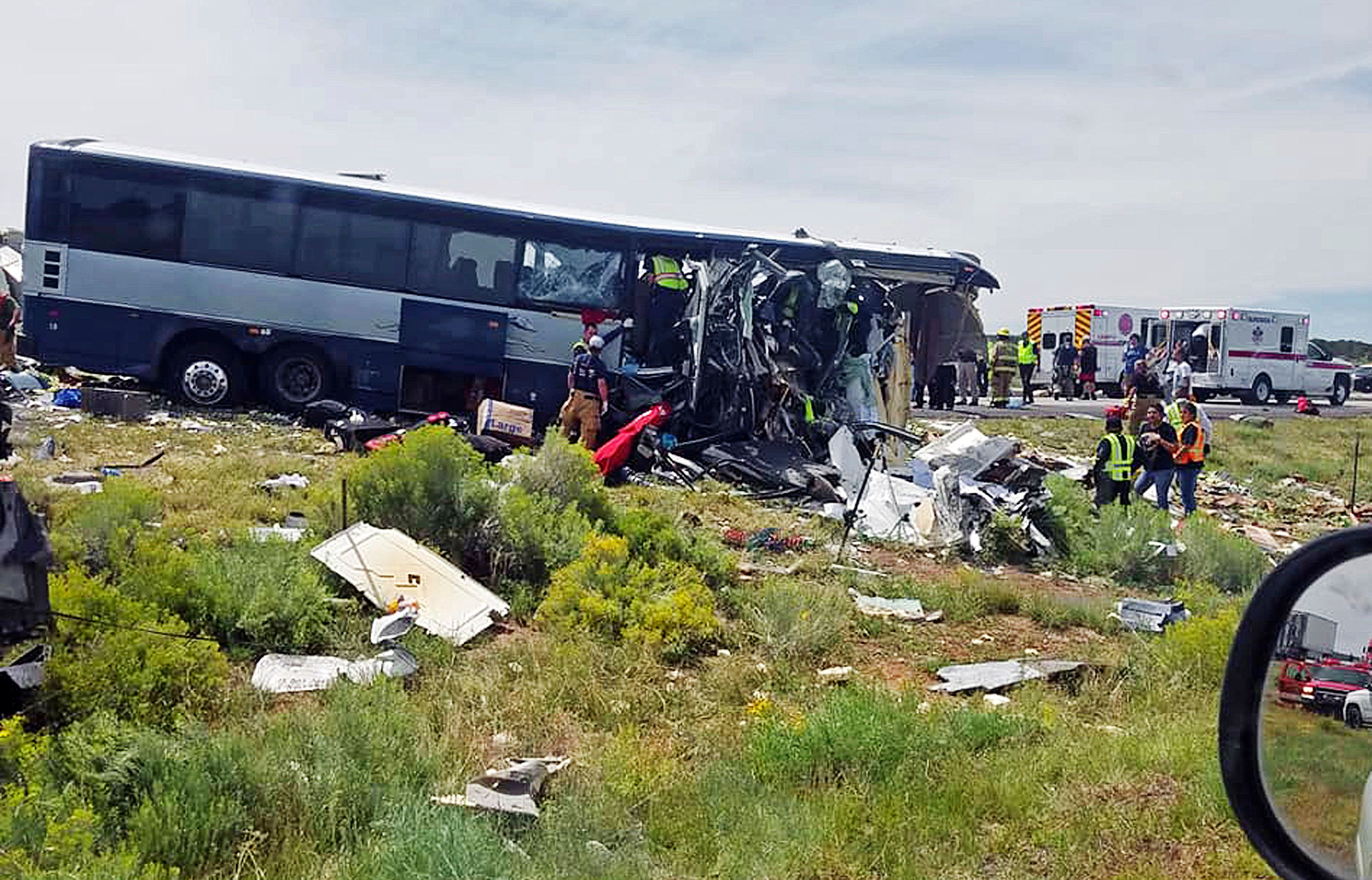 First responders work the scene of a collision between a Greyhound passenger bus and a semi-truck on Interstate 40 near the town of Thoreau NM near the Arizona border Thursday Aug 30 2018