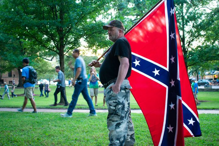 A protester holds a Confederate flag at a Thursday rally on the campus of the University of North Carolina, Chapel Hill.