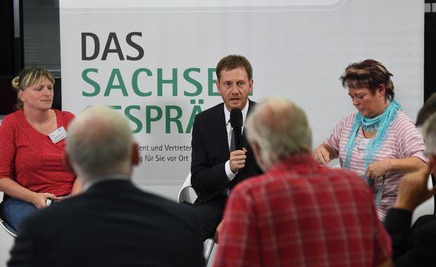Ministerpräsident Kretschmer (Mitte) beim