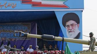 An Iranian army tank rolls past the tribune decorated with a portrait of Iran's Supreme Leader Ayatollah Ali Khamenei during a parade on the occasion of the country's annual army day on April 18, 2018 in Tehran. President Hassan Rouhani said during the parade that Iran 'does not intend any aggression' against its neighbours but will continue to produce all the weapons it needs for its defence. / AFP PHOTO / ATTA KENARE        (Photo credit should read ATTA KENARE/AFP/Getty Images)