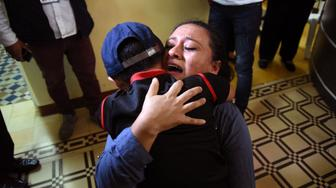 Lourdes de Leon hugs her son Leo -one of three minors who had been separated from their family on the U.S. border- upon arrival at the shelter 'Nuestras Raíces' in Guatemala City, on August 7, 2018. - Sixteen migrant minors returned to Guatemala on Tuesday, the local Chancellery reported. Three children between 5 and 10 years old returned to meet their respective parents who had been deported in the framework of the US immigration 'zero tolerance' policy. (Photo by ORLANDO ESTRADA / AFP)        (Photo credit should read ORLANDO ESTRADA/AFP/Getty Images)
