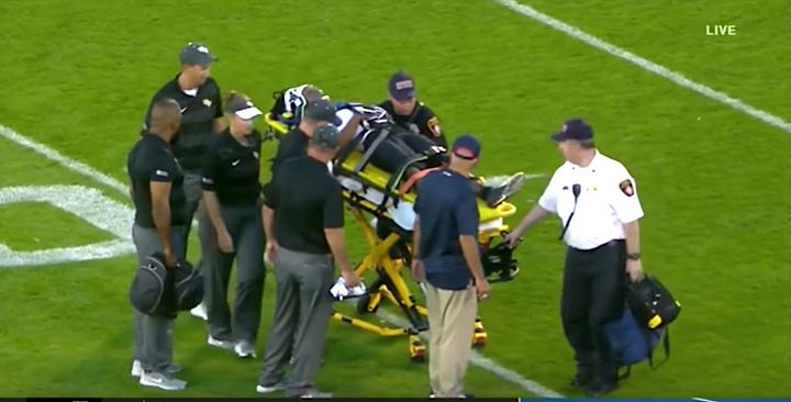 Medics tended to Aaron Robinson for nine minutes before he was carted off the field.