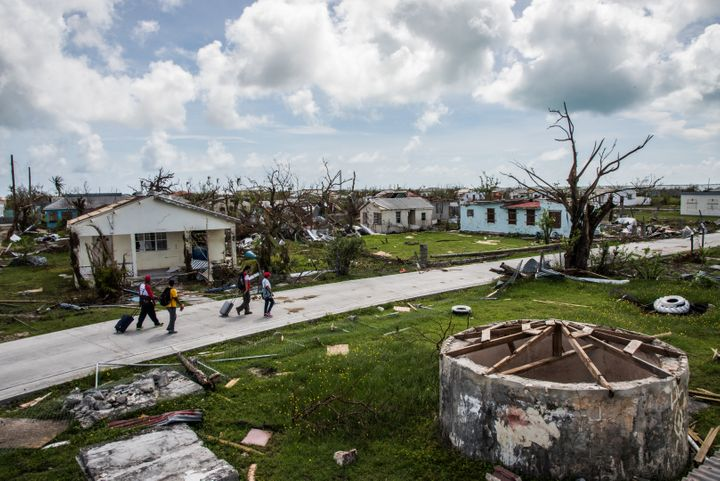 People survey damage on Barbuda, Sept. 24, 2017, in the aftermath of Hurricane Irma.