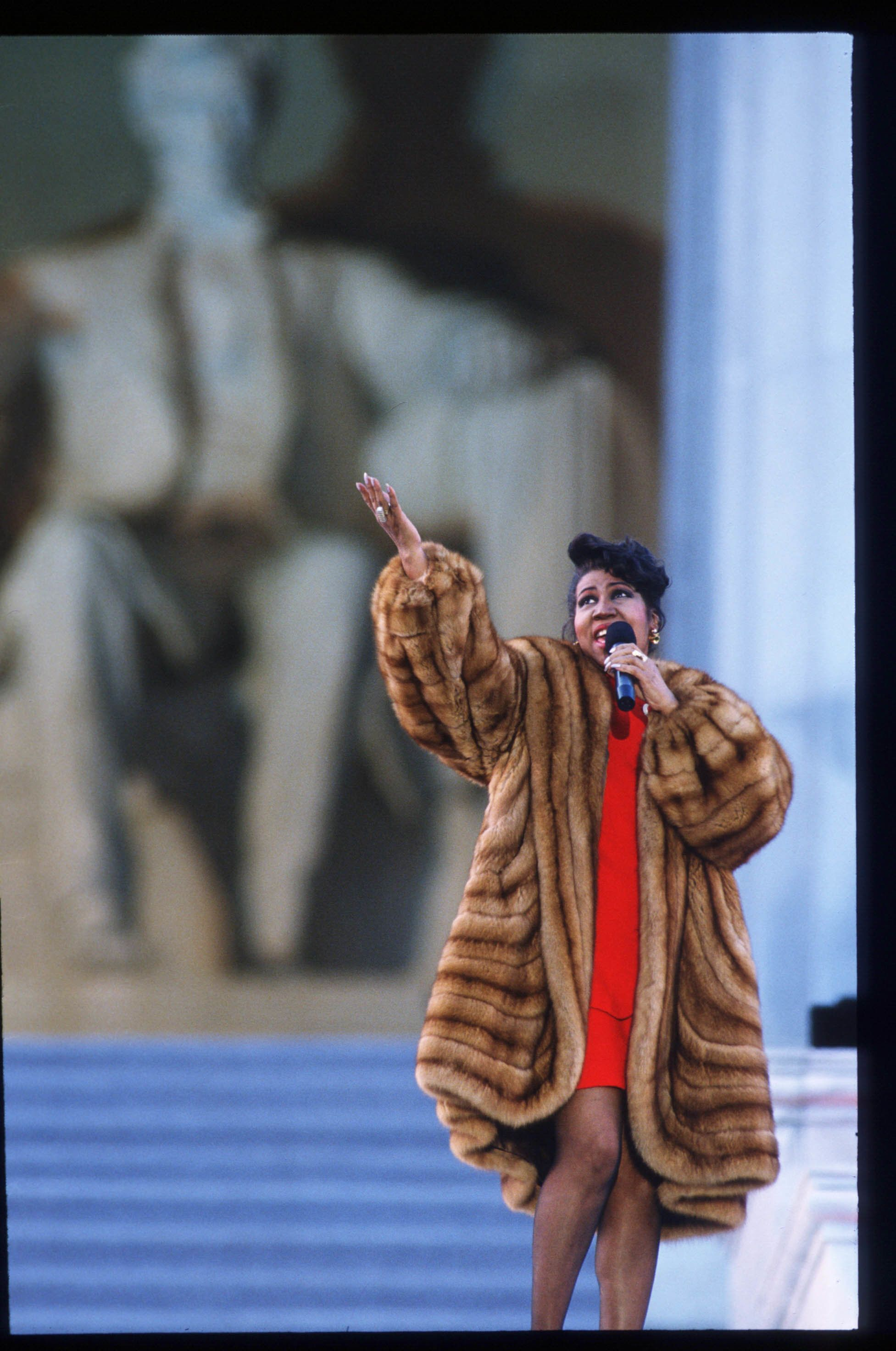 Aretha Franklin sings in front of the Lincoln Memorial on Jan. 17, 1993, days before President Bill Clinton's inauguration.