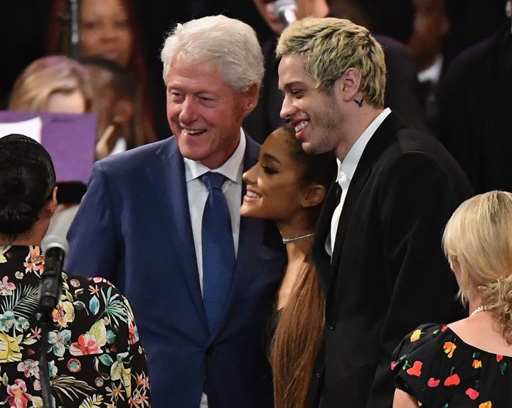 Bill Clinton takes a picture with Ariana Grande and her fiancé, Pete Davidson, at Aretha Franklin's funeral.