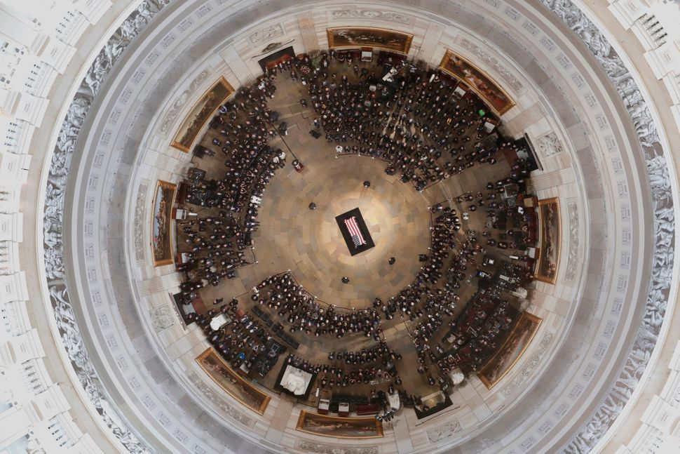 The casket of Sen. John McCain lies in state at the Capitol rotunda.
