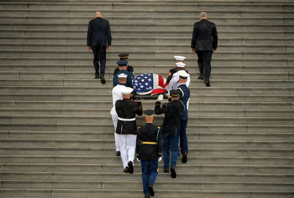 The casket of Sen. John McCain (R-Ariz.) is carried up the steps of the Capitol.