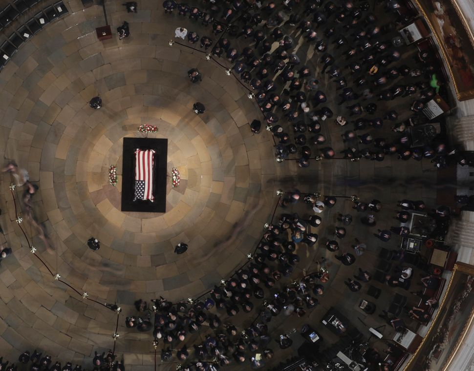 The casket in the Capitol rotunda.
