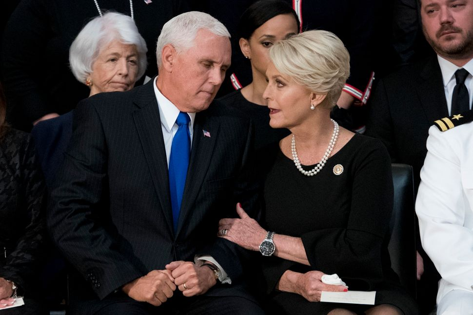 Vice President Mike Pence confers with Cindy McCain.