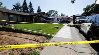 Sheriff's crime scene tape surrounds the house belonging to Joseph James Deangelo, who was arrested for the East Area Rapist/Original Night Stalker/Golden State Killer case in Citrus Heights, California, U.S., April 25, 2018.  REUTERS/Fred Greaves