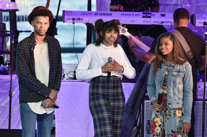 Aretha Franklin's grandchildren Jordan, Gracie and Victorie speak onstage at an Aug. 30 tribute concert at Chene Park —